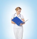 A young and attractive doctor checking the information Stock Photography