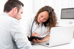 Young attractive doctor dating next appointment Stock Image