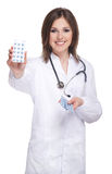 Young attractive doctor isolated over white Stock Photos