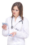 Young attractive doctor isolated over white Royalty Free Stock Photos