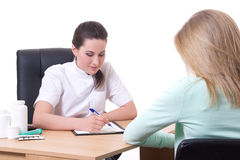 Young attractive doctor and patient Stock Images