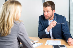 Young attractive employer doing a job interview to a woman Stock Photo