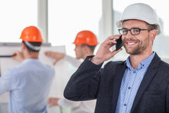 Young attractive engineer is communicating with Stock Images