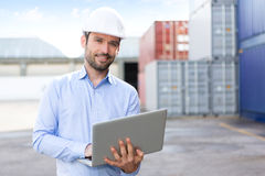 Young Attractive engineer using laptop on the dock Royalty Free Stock Images
