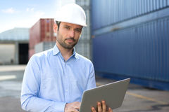 Young Attractive engineer using laptop on the dock Royalty Free Stock Photos