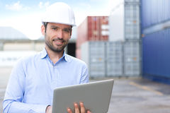 Young Attractive engineer using laptop on the dock Royalty Free Stock Photo