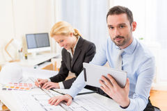 Young attractive engineer working at the office Royalty Free Stock Image