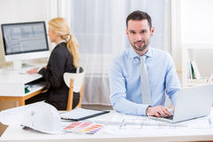 Young attractive engineer working at the office Royalty Free Stock Photography