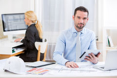 Young attractive engineer working at the office Stock Photography