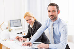Young attractive engineer working at the office Stock Images