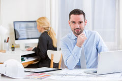 Young attractive engineer working at the office Stock Image