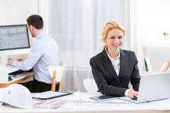 Young attractive engineer working at the office Royalty Free Stock Images