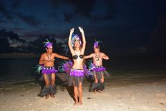 Polynesian Cook Islander dancers dancing on Muril beach lagoon i. Young attractive and exotic Polynesian Cook Islander dancers male and female dancing on Muril Stock Photography