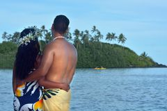 Young attractive and exotic Polynesian Cook Islander honeymoon c. Ouple at Muri lagoon in Rarotonga, Cook Islands. Real people. Copy space stock image