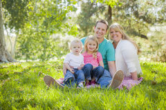 Young Attractive Family Portrait in the Park Royalty Free Stock Images