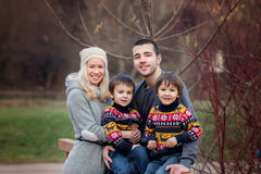 Young attractive family with two kids, young adults having fun o Stock Images