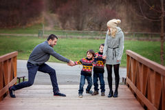 Young attractive family with two kids, young adults having fun o Royalty Free Stock Images