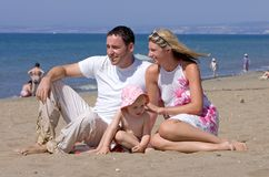 Young attractive family on vacation in Spain. Young attractive family on beach vacation in Spain on the Costa del Sol on a sunny day stock photo
