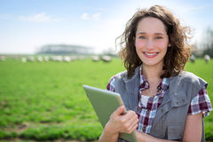 Young attractive farmer in a field using tablet Stock Photos