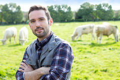 Young attractive farmer working in a field Royalty Free Stock Photography