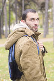 Young attractive fashion man with backpack Royalty Free Stock Photography