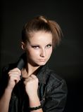 Young attractive fashion model posing on dark background. Royalty Free Stock Photo