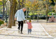 Young attractive father and little cute son playing in the park Royalty Free Stock Photos