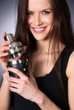 Young Attractive Female Bartender Smiling Mixes Martini Drink Stock Images