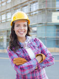 Young Attractive Female Construction Worker Wearing Hard Hat and Royalty Free Stock Photography