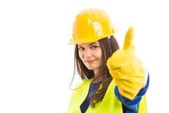Young female constructor showing thumb up stock image