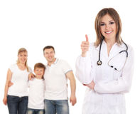 Young attractive female doctor and a family Stock Image