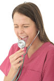 Young Attractive Female Doctor Screaming Down A Stethoscope Stock Photos