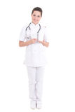 Young attractive female doctor standing with pills over white Stock Images