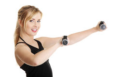 Young attractive female exercise using dumbbell Royalty Free Stock Images