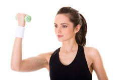 Young attractive female exercise using weights Royalty Free Stock Photography