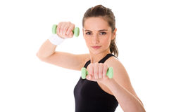Young attractive female exercise using weights Royalty Free Stock Photo