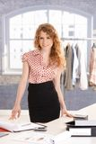 Young attractive female fashion designer working Royalty Free Stock Photo