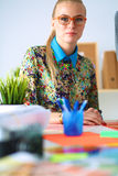 Young attractive female fashion designer working Stock Photography