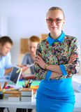 Young attractive female fashion designer working Royalty Free Stock Photos