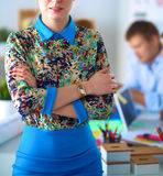 Young attractive female fashion designer working at office desk Royalty Free Stock Images