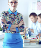 Young attractive female fashion designer working at office desk Stock Photos
