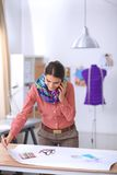Young attractive female fashion designer working Stock Images