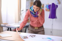 Young attractive female fashion designer working Royalty Free Stock Image