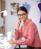 Young attractive female fashion designer working Stock Photos