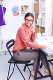 Young attractive female fashion designer working Stock Image