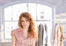 Young attractive female fashion designer working stock photo