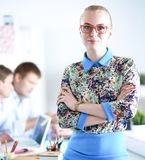 Young attractive female fashion designer working at office desk Royalty Free Stock Image