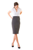 Young attractive female fixes her skirt, isolated Stock Photo