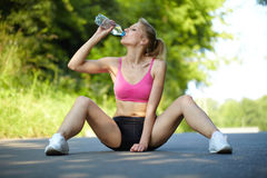 Young attractive female in her pink fitness outfit Stock Photo