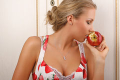 Young attractive female kissing an apple. Young attractive female holding and kissing an red apple Stock Photo